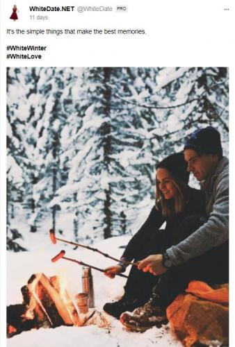 A young white couple sitting at a fireplace in winter landscape, alt-right dating