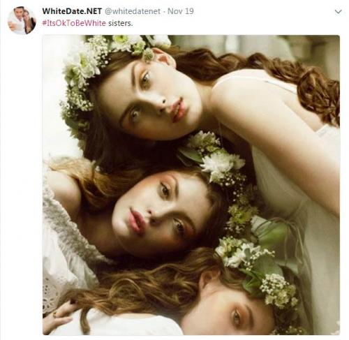Three gorgeous young white sisters with flowers in their hair