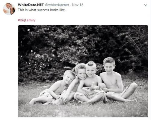 Five white boys sitting in the grass