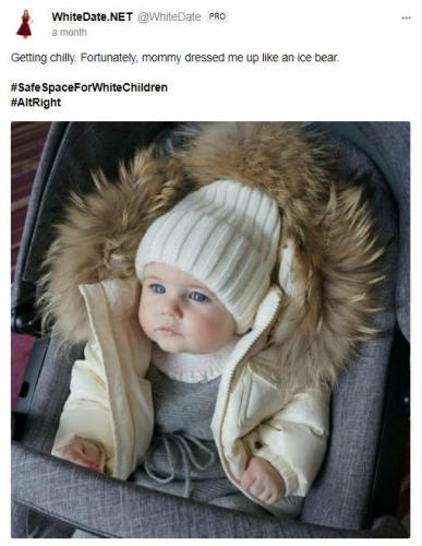 White baby dressed up for winter